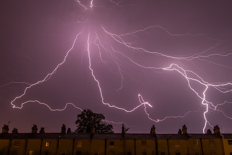 Low angle photography of lightning above building