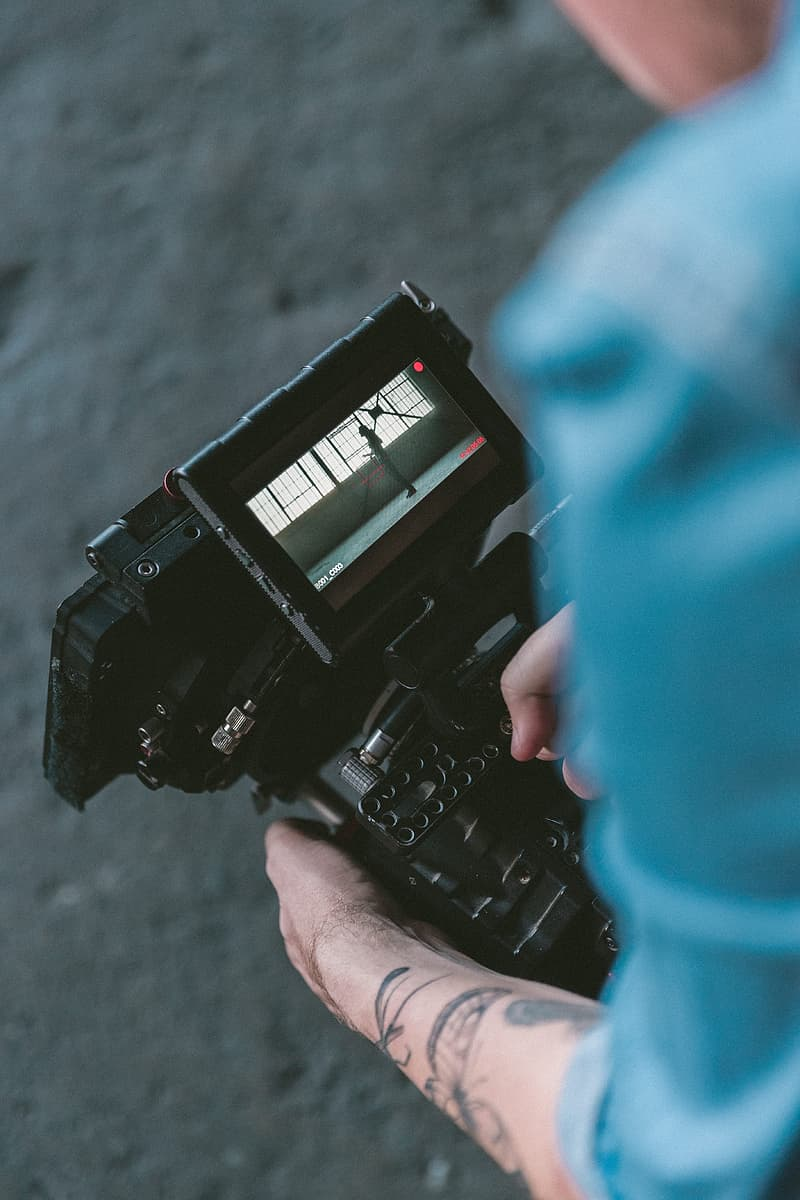 Person holding playing camera