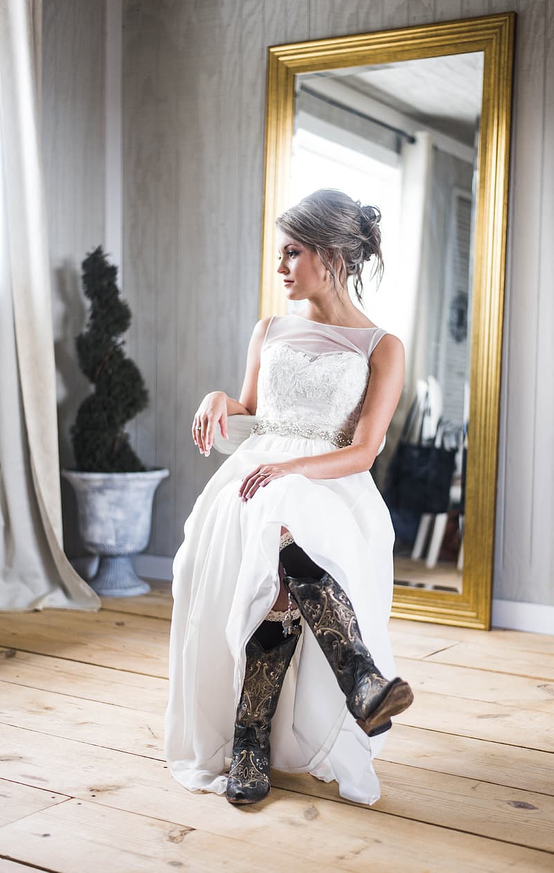 Woman sitting on chair wearing wedding gown