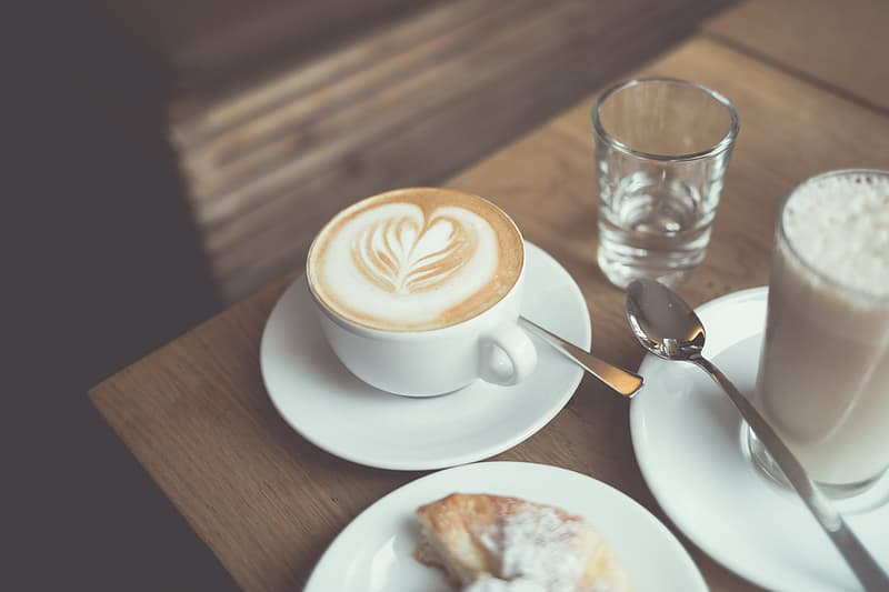 White ceramic teacup filled with coffee