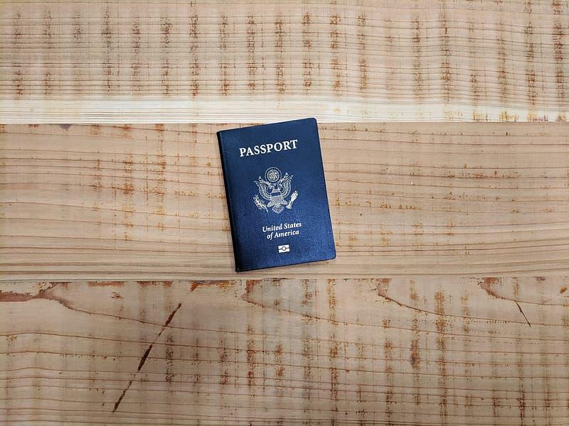 Black Passport on brown wooden planks